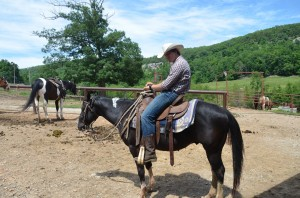 Bryan riding Phred and getting him ready to be put in the dude string.
