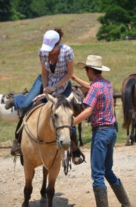 One of the wranglers job is fitting the rider to a horse.