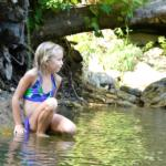 young girl at the Horseshoe Canyon Ranch swimming hole