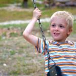 small child on a swing at Horseshoe Canyon Ranch