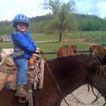 small child on a horse at Horseshoe Canyon Ranch