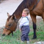 little boy with horse at Horseshoe Canyon Ranch