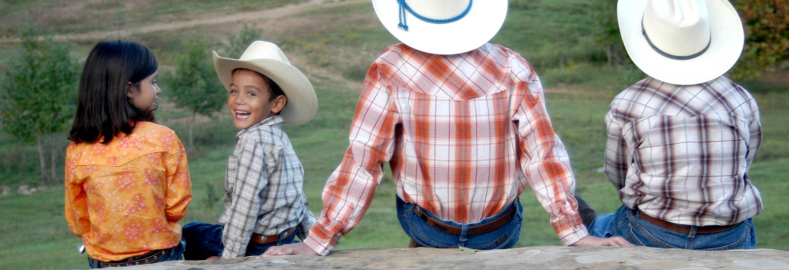 Cowboy kids with backs to camera
