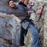 2 people rock climbing