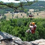 setting off on the zipline at Horseshoe Canyon Ranch